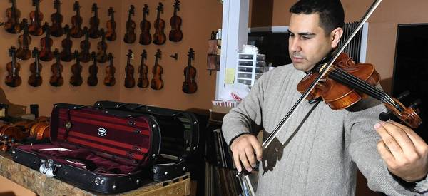 Mike Montero, who moved his violin business from Syracuse, N.Y. to Chestnut Street in Emmaus, is among the influx of New Jersey residents adding to the Lehigh Valley's population growth.