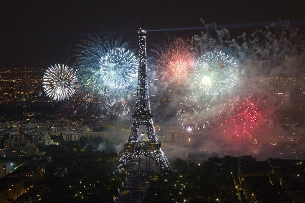 The Eiffel Tower is illuminated during the traditional Bastille Day fireworks display in Paris July 14, 2012.