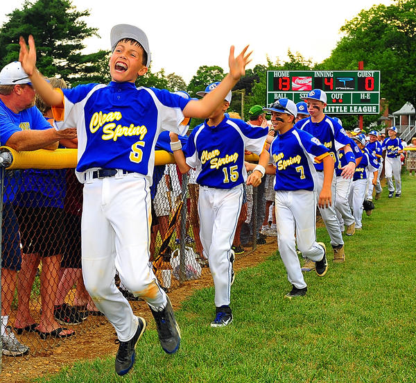 Clear Spring players celebrate their win in the Maryland District 1 11-12 Tournament with a victory lap around the field.