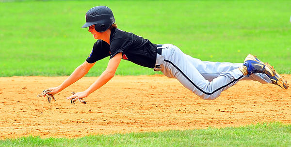 Funkstowns Brandon Greene goes head first safely into second on a stolen base in the first game of a doubleheader sweep of Brunswick on Saturday.