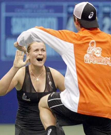 Anna-Lena Groenefeld, left, of the Orange County Breakers, celebrates with teammate John-Patrick Smith, right, after defeating Asia Muhammad, of the Sacramento Capitals, in a singles match at the Bren Events Center Saturday.