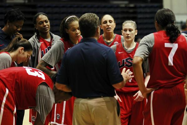 United States head coach Geno Auriemma talks to his team on the court during USA women's team training at Bender Arena on the campus of American University.