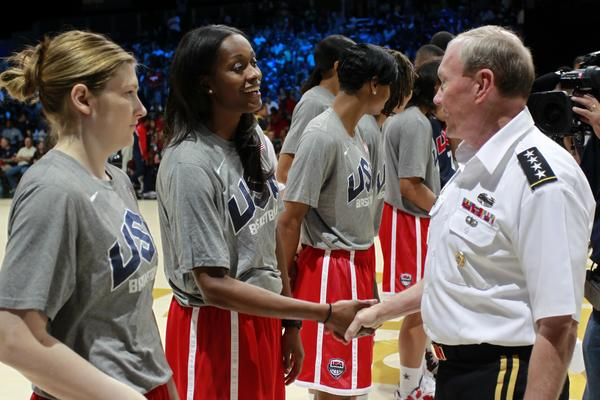 Chairman of the Joint Chiefs of Staff U.S. Army General Martin E. Dempsey (right) shakes hands with Swin Cash as he greets members of the United States women's team during USA team training at the DC Armory.