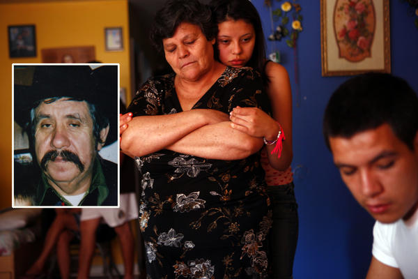 Angelica Mora hugs her mother Maria Carmen Mora at their North Side home in Chicago July 15, 2012, as her brother Emmanuel Mora (far right) talks about the beating death of their father Delfino Mora (inset, left), as he was collecting cans in a West Rogers Park alley Tuesday.