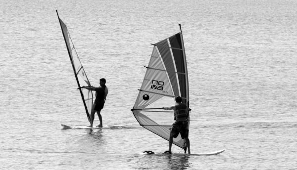 Wind surfers beat the intense Chicago heat by taking a trip on Lake Michigan, just off the shores of the Clark Street Beach in Evanston Sunday.