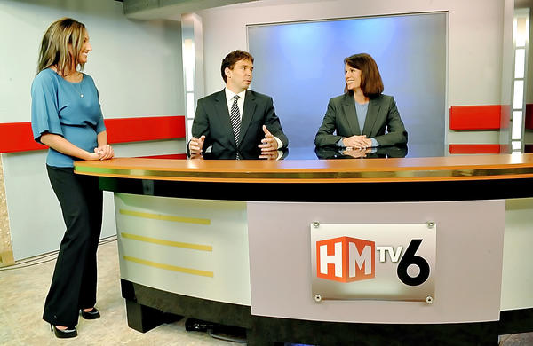 HMTV6 Meterologist Brittany Beggs, left, news anchors Hans Fogle and Raychel Harvey-Jones are shown on the set of HMTV6.