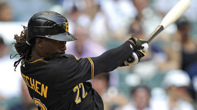 Pittsburgh Pirates' Andrew McCutchen singles against the Milwaukee Brewers during the ninth inning on Sunday.