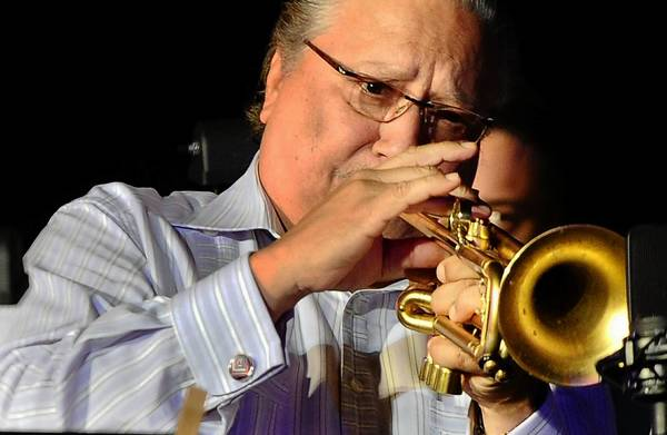 Trumpeter Arturo Sandoval performs at artistic director Rachael Worby's new orchestra - MUSE/IQUE - Summer Series Opening at Caltech's Beckman's Mall on July 14 in Pasadena.