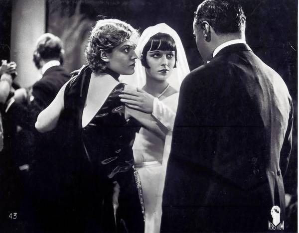 "Louise Brooks, center, with Alice Roberts in the 1929 German film ""Pandora's Box."""