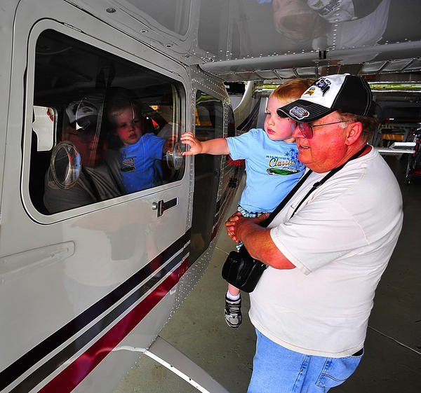 Vince Budny and his grandson Connor Buckley peek inside a single-engine airplane Sunday during Hagerstown Aviation Museum's Open Airplane Afternoon.