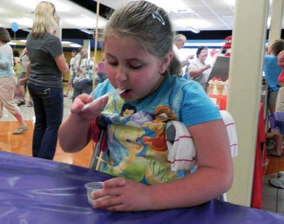 All-you-can-eat ice cream at Saturday's Scoop-a-Palooza was just the right medicine to make Hannah Wagner, 7, of Waynesboro, Pa., feel better after breaking her leg this summer.