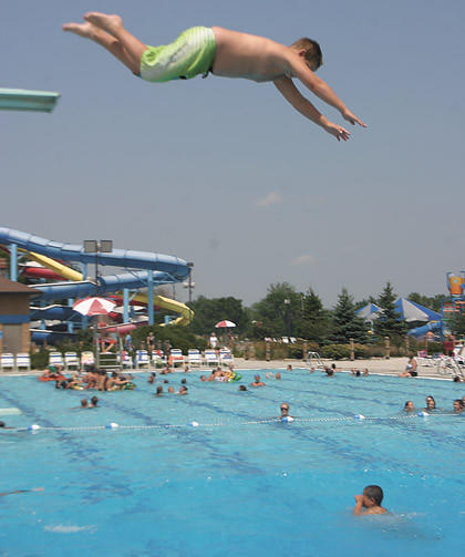Landon Danielson, 12, leaps off the high diving board Friday at the Aberdeen Aquatic Center.