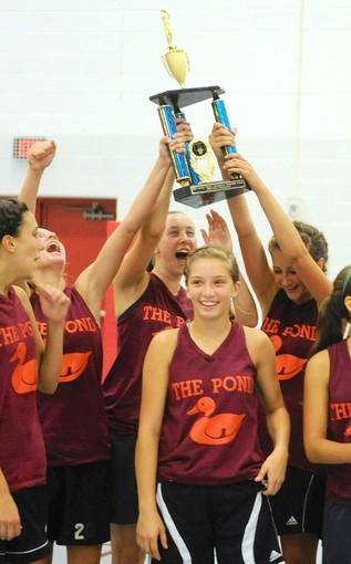 The Notre Dame-Green Pond girls basketball team holds the championship trophy after winning the Stellar tournament.