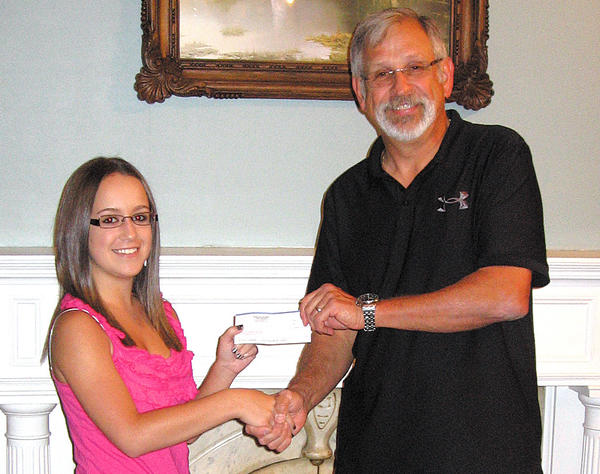 Ashley Keedy of Boonsboro was awarded an Alsatia Club Foundation Scholarship from Alsatia Club President Doug Snyder. Andrew Shupp of Clear Spring also received a scholarship.