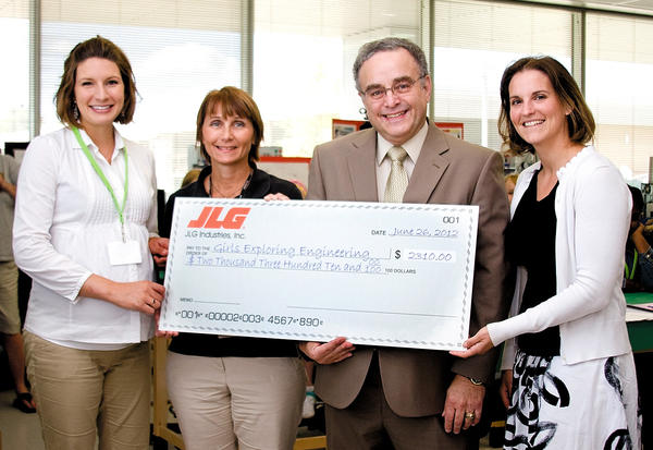From left, Stephanie Rittler, instructor of mechanical engineering technology at HCC; Joan LaSalle, senior chief engineer at JLG; Guy Altieri, president of HCC; and Cathy Martin, design engineer at JLG.