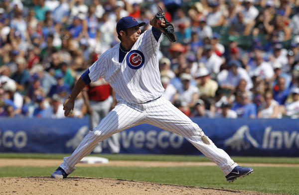 Matt Garza pitches against Arizona Sunday at Wrigley Field.