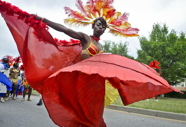"A dancer with Fiyah Bird Productions performs ""Fantasy Revelers of the Nile"" at the 2012 Caribbean Parade in Baltimore."