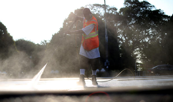 Geoffery Morson of Powerclean sprays off Columbus Drive after the Taste of Chicago in Chicago Monday.