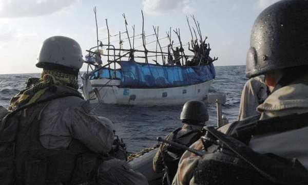 A U.S. Coast Guard Maritime Safety and Security Team investigate a Somali skiff.