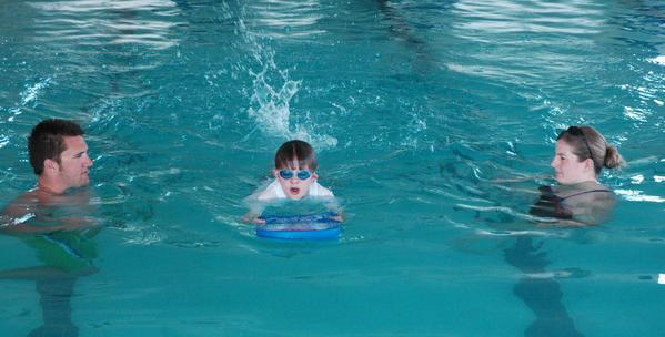 Megan Wuerth (right) and Casey Riley give smi-private swim lessons to Josh Doctor, 9.