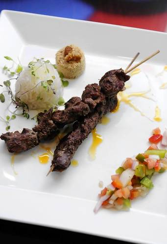 The Filet Mignon A La Campana, an appetizer, is seasoned with Brazilian herbs and served with fresh salsa at Rio.