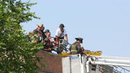 Chicago Fire Department crews bring the victim of a building collapse in West Pullman down from an adjacent building that did not fall this morning. Eric Clark, for the Tribune
