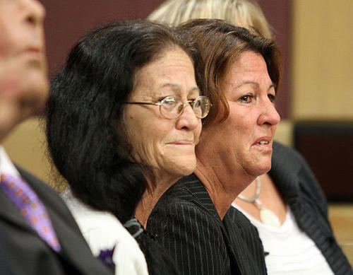 Donna Powers, Wayne Treacy's mother, left, cries ahe  is lead way in handcuffs after a guilty verdict in his he attempted murder trial at the Broward County Courthouse in Ft. Lauderdale on Monday.