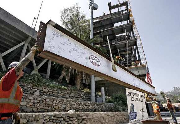 Crews raise the final piece of structural steel in the Rose Bowl renovation during official Topping Out ceremony at the Rose Bowl in Pasadena on Wednesday, June 20, 2012.