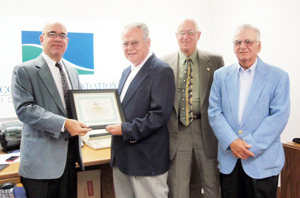 JUMP board members Dennis Pentrack, Walter Friedhoff and Malcolm Snyder presented Foundation Director Mike Kane with a certificate of appreciation.