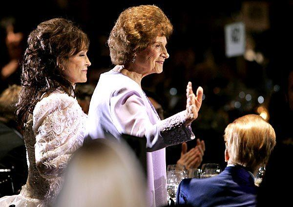 Kitty Wells with Loretta Lynn, left, at the BMI Country Awards.