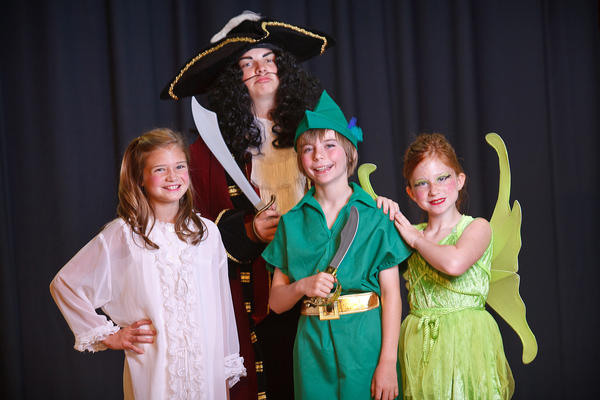 From left, Grace Bowers as Wendy, Zachary McDonald as Capt. Hook, Brady Johnson as Peter Pan and Caroline Bowers as Tinkerbell in Peter Pan.