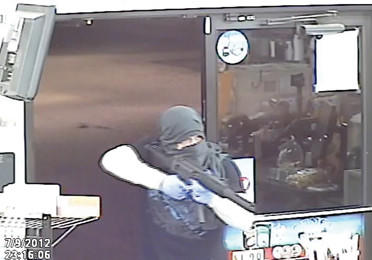 Washington Township (Pa.) Police released this photo of an armed robber holding up the Blue Ridge Food Mart on Pa. 16 in Blue Ridge Summit, Pa. The robbery took place July 9.