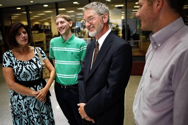 Former Lake County Chief Judge David Hall talks to reporters Monday with his wife, Karen, and sons Bjorn, 23, left, and Soren, 32, during a break in his DUI trial. He was acquitted of that but was convicted of resisting arrest.