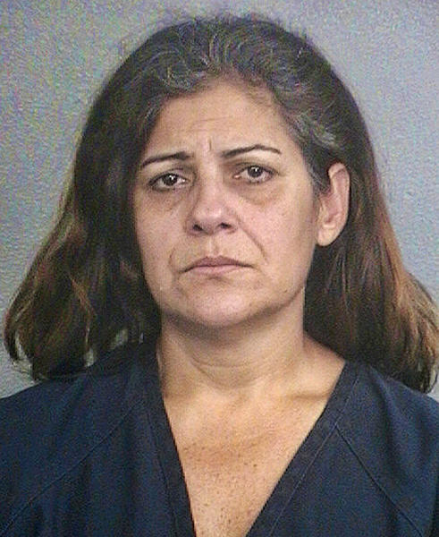 Janiber Vieira, mother of fugitive Boynton Beach Policee Officer David Britto, is accused of helping him flee the country to avoid drug charges