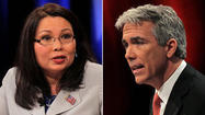 Democratic challenger Tammy Duckworth outraised Republican Rep. Joe Walsh by a better than 2-1 ratio from April to June, and both candidates in the heated 8th Congressional District contest began this month with more than $700,000 to spend.