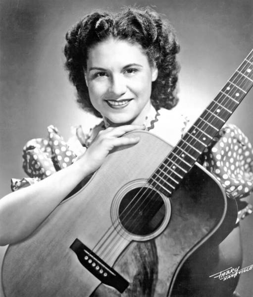 "Kitty Wells laid a template for female singers in country music that started a shift in traditional male-female roles in rural America with ""Honky Tonk Angels."" She was elected to the Country Music Hall of Fame in 1977."