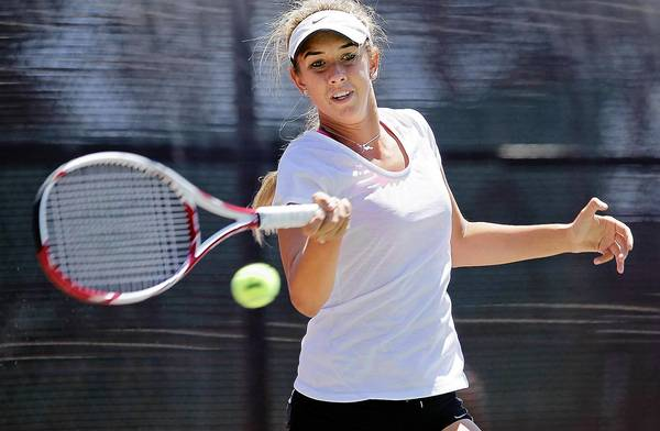 Annie Radeva, from Newport Beach, returns a serve during a match at the Costa Mesa Tennis Club on Monday.