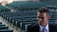 A Massachusetts woman previously warned to stay away from Chicago Cubs president Theo Epstein flew to Chicago to stalk him and was arrested after trying to bring a birthday gift for the family's young son to his Lakeview home, prosecutors said in court today.