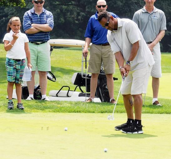 Andre Reed putts during his third annual celebrity golf tournament on Monday at Lehigh Country Club.