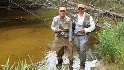 Richard Keiswetter (left) and Jim Tisdel, key members of Reel Waters team of fly fishing guides, pause before fishing the Maple River near Brutus.