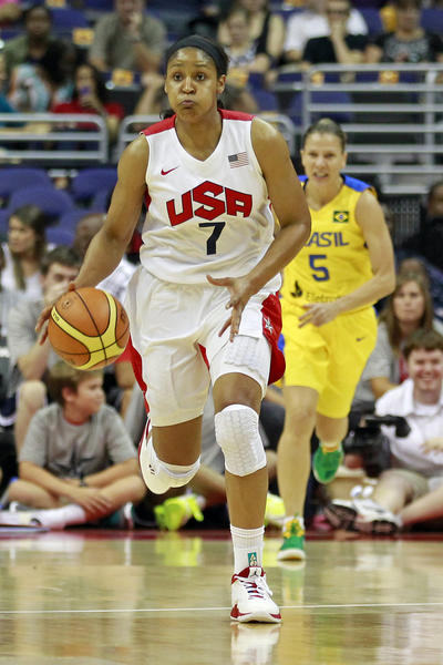 United States forward Maya Moore (7) dribbles the ball against Brazil in the first half at Verizon Center. Team USA won 99-67.