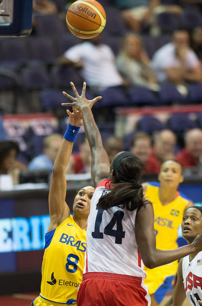 Brazils's Iziane Castro Marques (8) shoots over USA's Tina Charles (14) during the first half at the Verizon Center in Washington, D.C., Monday, July 16, 2012.