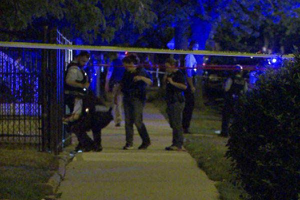 Police investigate a shooting early this morning in the 8400 block of South Morgan Street.