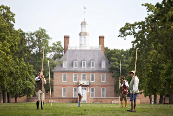 From left, Alan Burkett, 13, Michael Luck, 12, Matt Bingham and Nathan Ryalls, family program interpreters of Colonial Williamsburg, work on setting up goal posts for Native American football in Colonial Williamsburg on Monday morning. The football is one of Colonial games, which they present to visitors.