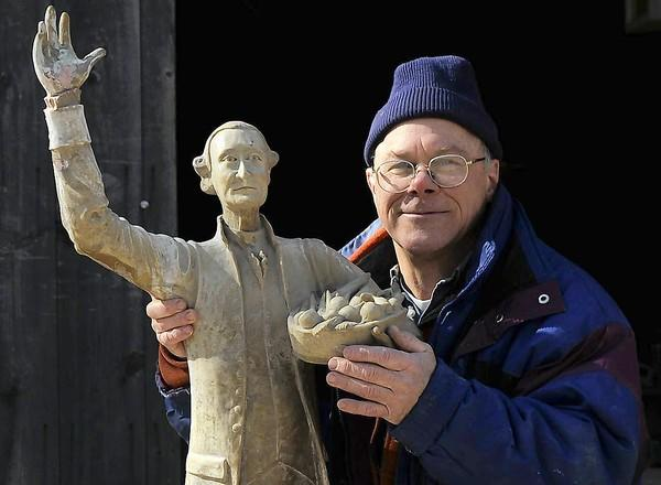 Sculptor Randall Nelson poses with a new fiberglass statue he created of Jonathan Trumbull. In 1996, he created eight statues of famous figures of Connecticut history, which were placed on top of flagpoles surrounding the Old State House in Hartford.