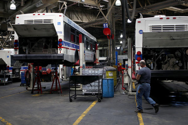 Buses on jacks are set for maintenance at the CTA Kedzie Avenue garage on Tuesday. The CTA will spend $205 million to upgrade bus and rail maintenance facilities over the next three years, officials said.
