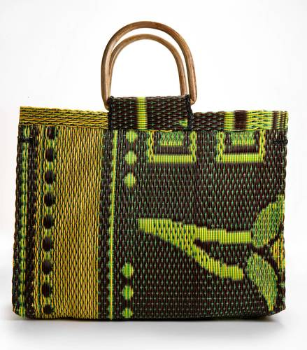 "Imandeco multicolore woven plastic tote with wooden handles, $55 at Ikram; <a href=""http://Ikram.com"">ikram.com</a> for details."