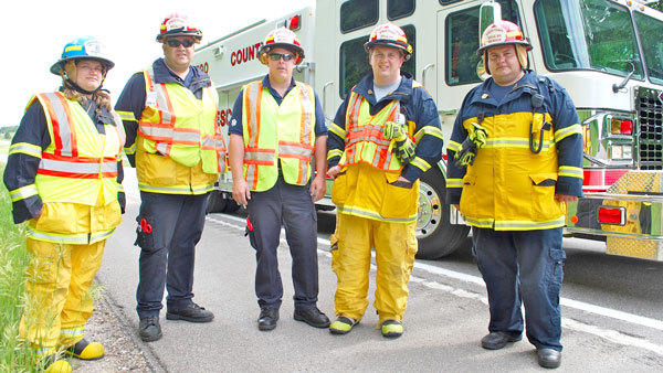 Otsego County EMS/Rescue personnel stand by the departments heavy rescue truck after they had finished responding to a crash on I-75 last month. The truck is equipped with multiple Jaws of Life tools, fire suppression, extra air tanks and aerial lighting for nighttime emergency scenes. Pictured are (l-r) Jessica Basinski, Mike Watson, Brian Haag, Mike Martin and Dan Moore