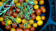 The arrival of tomatoes at the farmers' market is the high point of the summer growing season. It brings with it a treasure-trove of jewel-colored fruit that span the spectrum from bright green to dark purple and come in shapes that defy geometric reason. Heirloom tomatoes with names such as Green Zebra and Black Krim deliver a range of flavors from tongue-twisting tartness to luxurious, smooth sweetness.