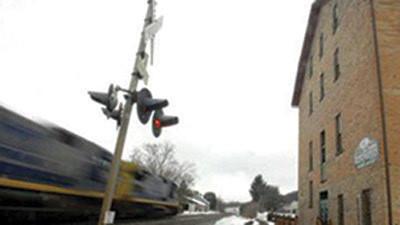 An Amtrak train travels through Rockwood Borough.